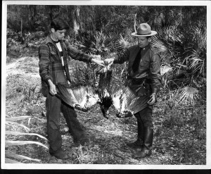 Photo Dr. Mount with a game warden and a golden eagle.